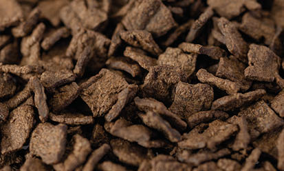 The small, brown Trigovit® Tex Flakes SDM 112 are textured wheat proteins for use in animal feed   Crespel & Deiters